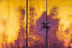Old paint horizontal door background yellow and purple Royalty Free Stock Photography
