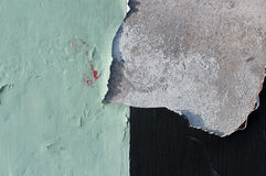 Old paint peeling of concrete wall, texture Stock Images
