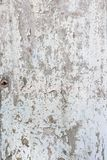 Old paint peeling from white door Royalty Free Stock Photo