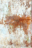 Old paint on rusty metal texture. Old paint white on rusty metal texture Royalty Free Stock Photo