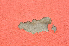 Old paint and wall, cracked wall color orange. Royalty Free Stock Image
