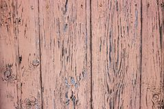 Old paint on wood. Decorative background of old wood with old paint. Stock Image