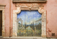 Old paint on wood door Village Roussillon ochres, France Stock Photo
