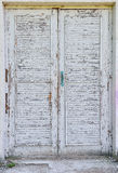 Old paint on wooden door Stock Images