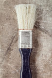 Old paintbrush on a dirty canvas Stock Images