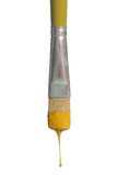 Old Paintbrush Dripping Yellow Paint Royalty Free Stock Images