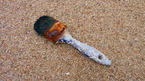 Old paintbrush. Rusty old paintbrush and with traces of a prolonged period spent at sea Royalty Free Stock Images