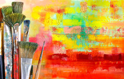 Old paintbrushes. On painted background royalty free stock photos