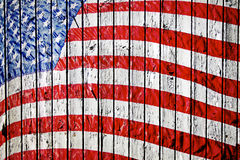 Old Painted American Flag. On Dark Wooden Fence Stock Photography