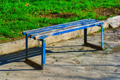 Old painted bench. In garden royalty free stock photography