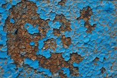 Old Painted Blue Wall. Background. Cracked Flaked Shabby Wall With Rundown Stucco Layer Texture royalty free stock photo