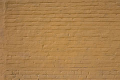 Old painted brick wall. Aged brick texture. Grunge color background Royalty Free Stock Images