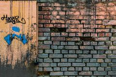 Old painted brick wall with black paint drips stock image