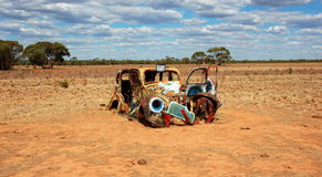 Old painted car in Mungo National Park, Australia. The central feature of Mungo National Park is Lake Mungo, the second largest of the ancient dry lakes Royalty Free Stock Photos