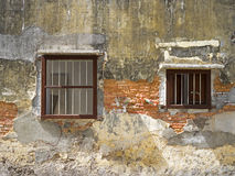 Old painted concrete wall. With two windows Royalty Free Stock Photos