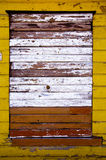 Old painted and cracked wooden wall Royalty Free Stock Images
