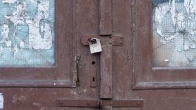 Old painted door with lock. glass appeared. Old painted door with lock, glass appeared royalty free stock image