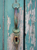 Old Painted Door With Handle And Keyhole Stock Photo