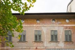 Old painted house with shutters in Levico Termen, Italy royalty free stock photos