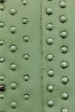 Old painted metal background detail of a military aircraft, surface corrosion. Royalty Free Stock Photo