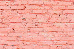 Old painted red brick wall, natural rough gritty texture to the background. For natural design, patterns, background Stock Image