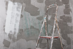 Old painted and stucco ladder on concrete wall background Stock Images