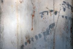Old painted texture of rusty metal wall royalty free stock image