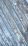 Old painted texture vintage wood background with peeling paint. Painted weathered plain teal blue and white Rustic Wood royalty free stock photo