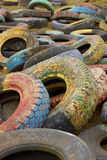 Old painted tires. Couple old painted tires on the gabarge royalty free stock photography