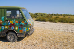 Old Painted Van in the desert Stock Photography