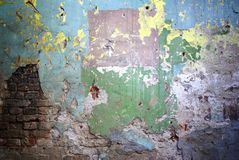Old painted wall with the bricks texture Stock Image
