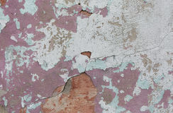 Old painted wall. Green and pink damage surface. Peeling paint background. Stone demaged backdrop. Stock Photo