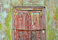 Old painted wall with window shutters closed Royalty Free Stock Image