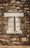 Old, Painted Window Set in Stone Wall Stock Images