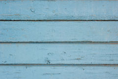 Old painted wood. Background texture of old, weathered blue fence on a farm with chipping paint royalty free stock photography