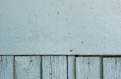 Old painted wood. Background texture of old, weathered blue wall on a house with chipping paint Stock Photography