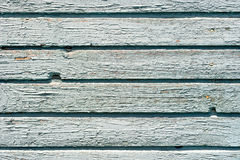 Old painted wood. Background texture of old, weathered blue wall on a house with chipping paint stock image