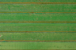 Old painted wood. Background texture of old, weathered green fence on a farm with chipping paint royalty free stock images