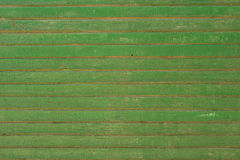 Old painted wood. Background texture of old, weathered green wall on a farm with chipping paint Stock Images