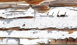 Old painted wood. Old wooden wall with paint coming off Stock Photos