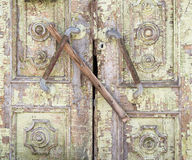 Old painted wooden boarded door. As grunge background composition Royalty Free Stock Photos