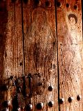 Old painted wooden church door Royalty Free Stock Image