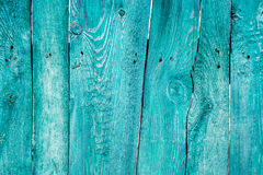 Old painted wooden fence background. Texture for design Stock Photos