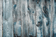 Old painted wooden fence background. Texture for design Royalty Free Stock Image