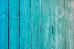 Old painted wooden fence background. Texture for design Stock Image