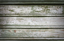Old painted wooden vintage wall. Close-up old painted wooden vintage background Royalty Free Stock Photography
