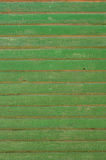 Old painted wooden wall. Background texture of old, weathered green wall on a farm with chipping paint stock photo