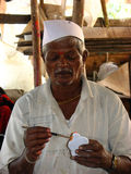 Old Painter. A tired old Indian artist painting some clay toys Royalty Free Stock Photography