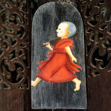 Old painting of novice in temple. This is traditional and generic style in Thailand. No any trademark or restrict matter in this photo stock image