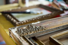 Old paintings frames. Old wooden painting frames in painter studio stock photo